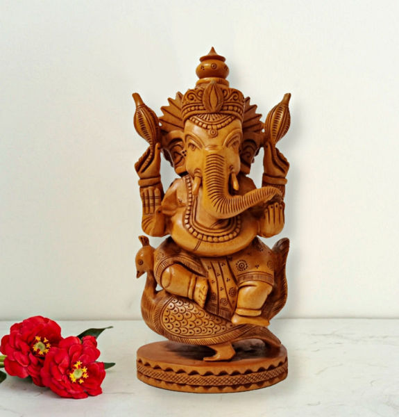 Wooden Lord Ganesha statue on peacock